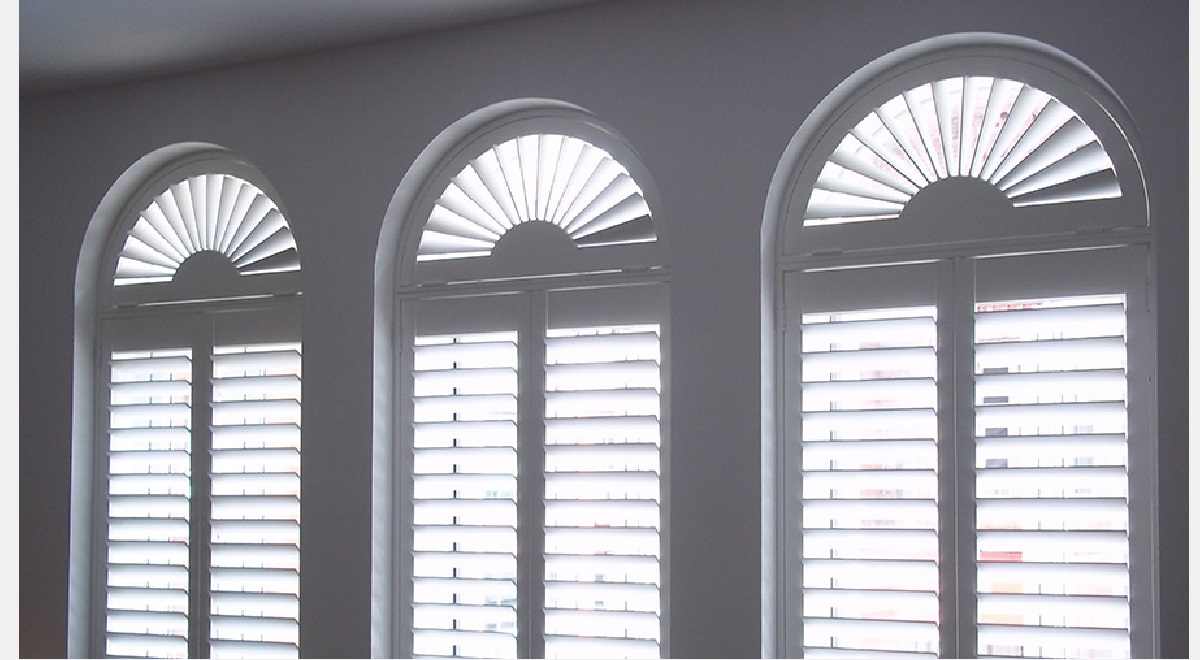 Full Height white Arched Hardwood Plantation Shutters