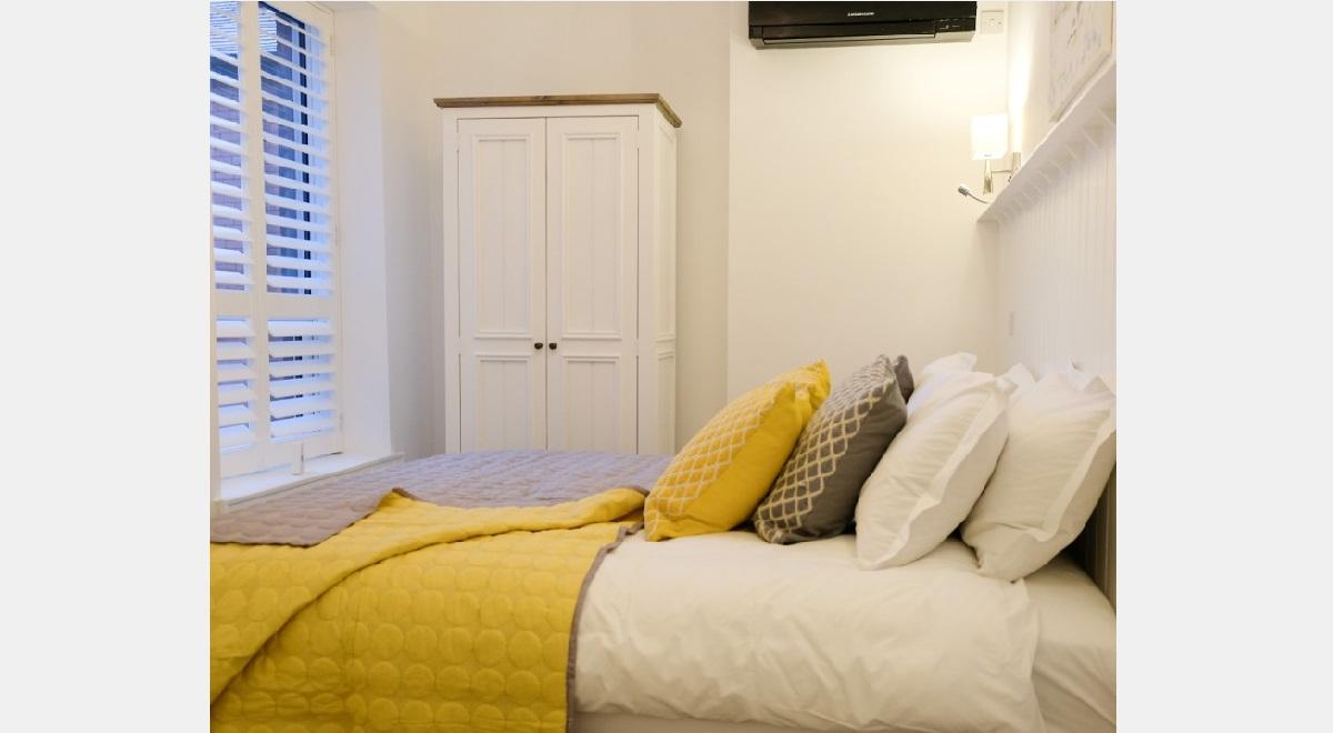Full Height white Hardwood Plantation Shutters in Master Bedroom Window